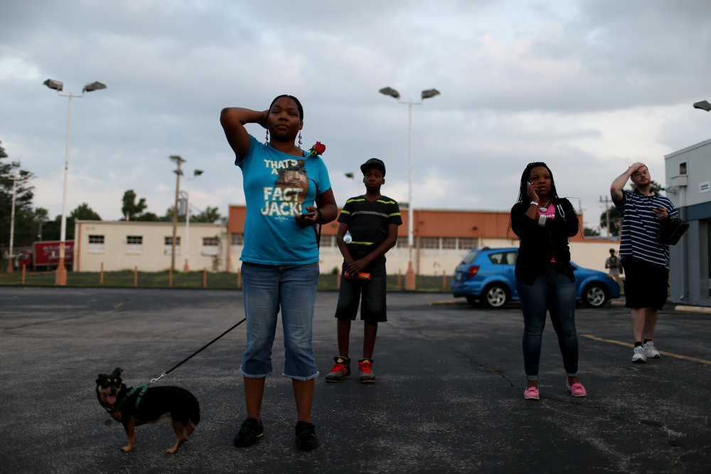 . Demonstrators protesting the shooting death of Michael Brown listen as rapper, Nelly, speaks to them on August 18, 2014 in Ferguson, Missouri. Protesters have been vocal asking for justice in the shooting death of Michael Brown by a Ferguson police officer on August 9th.  (Photo by Joe Raedle/Getty Images)