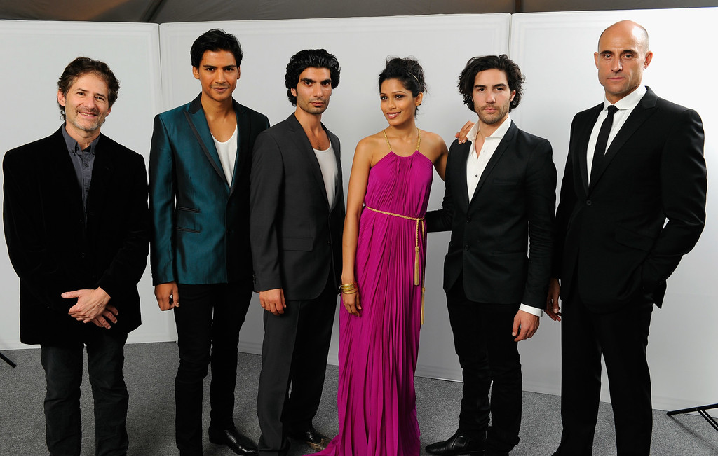 . (L-R) Composer James Horner, actors Jan Uddin, Akin Gazi, Freida Pinto, Tahar Rahim and Mark Strong pose for a portrait in the portrait studio at Katara Cultural Village during the 2011 Doha Tribeca Film Festival on October 25, 2011 in Doha, Qatar.  (Photo by Andrew H. Walker/Getty Images for Doha Film Institute)