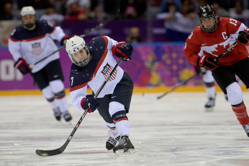 . Monique Lamoureaux (7) of the U.S.A. takes a shot against Canada during the third period of the women\'s gold medal ice hockey game. Sochi 2014 Winter Olympics on Thursday, February 20, 2014 at Bolshoy Ice Arena. (Photo by AAron Ontiveroz/ The Denver Post)