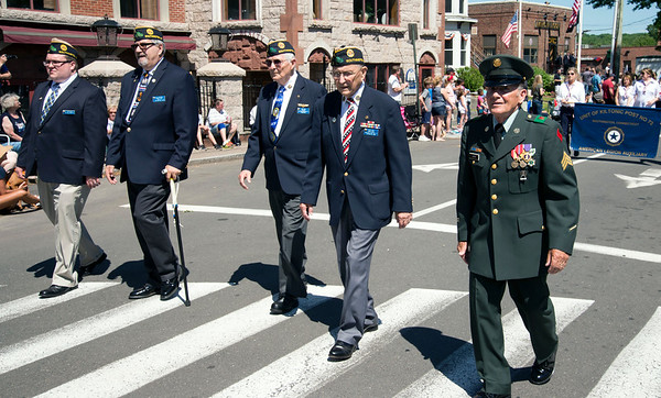 05/27/19 Wesley Bunnell | Staff Veterans and members of the American Legion Post 72 march down Main St during Monday mornings Memorial Day Parade including Louis Urso, R who served one year in Vietnam. His medals include the Purple Heart and Bronze Star with V to indicate &quote;participation in acts of heroism involving conflict with an armed enemy.&quote;