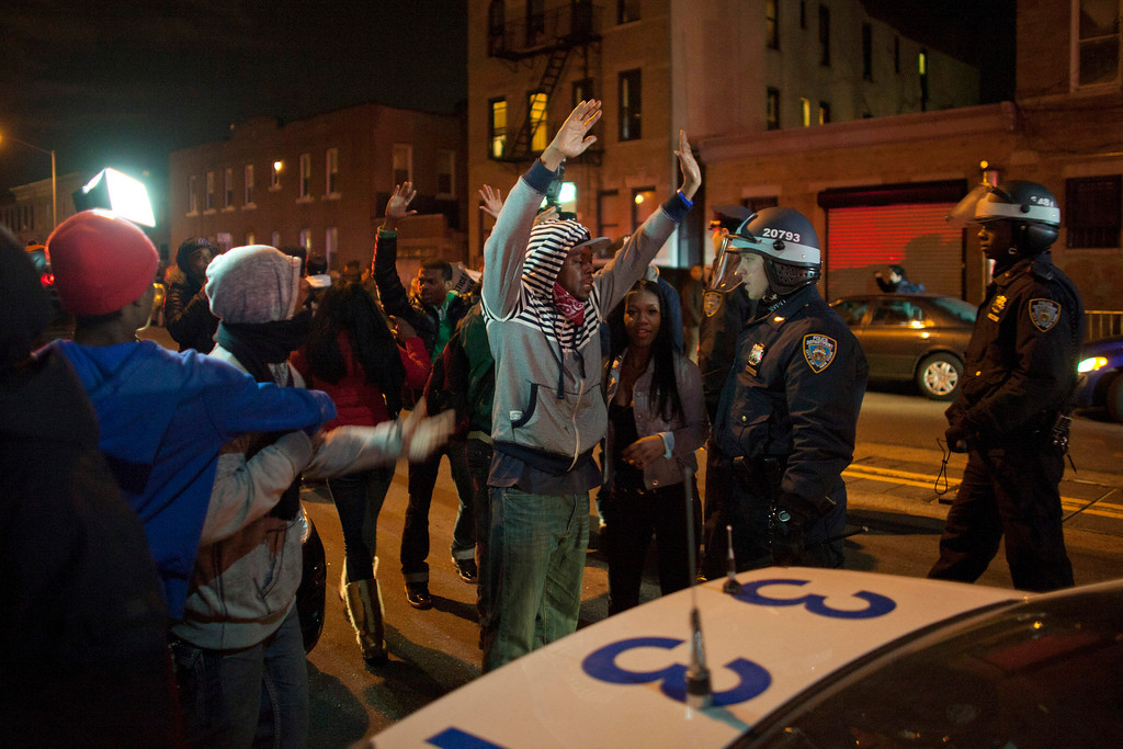 ". People confront New York Police Department (NYPD) officers during a protest against the killing of 16-year-old Kimani ""Kiki\"" Gray who was killed in a shooting involving the NYPD, in the Brooklyn borough of New York March 13, 2013. REUTERS/Eduardo Munoz"