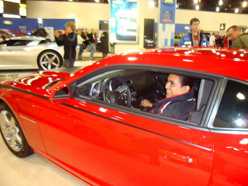 Rigo in his favorite car, the Camero.