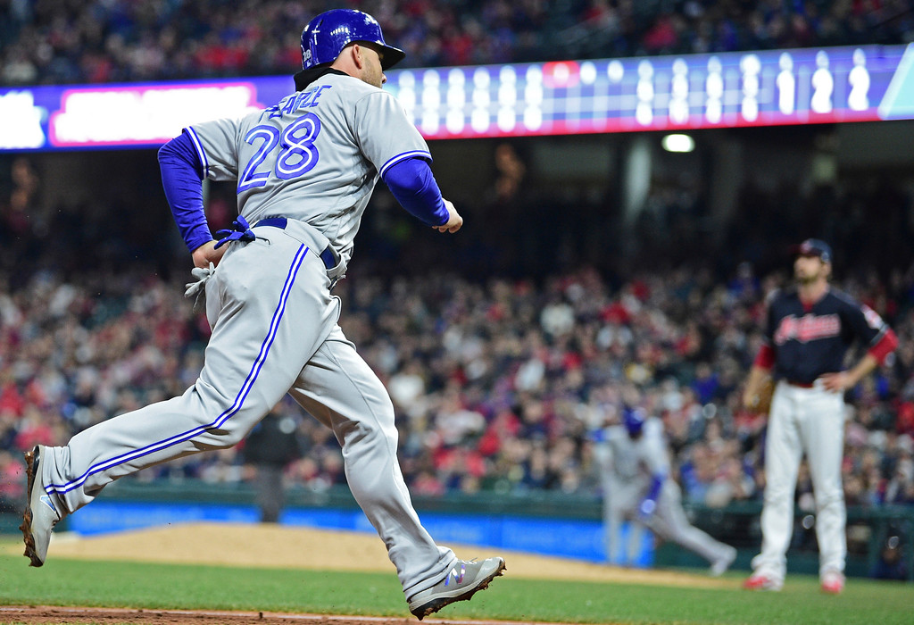 . Toronto Blue Jays\' Steve Pearce scores on a double by Teoscar Hernandez in the seventh inning of a baseball game against the Cleveland Indians, Friday, April 13, 2018, in Cleveland. The Blue Jays won 8-4.(AP Photo/David Dermer)