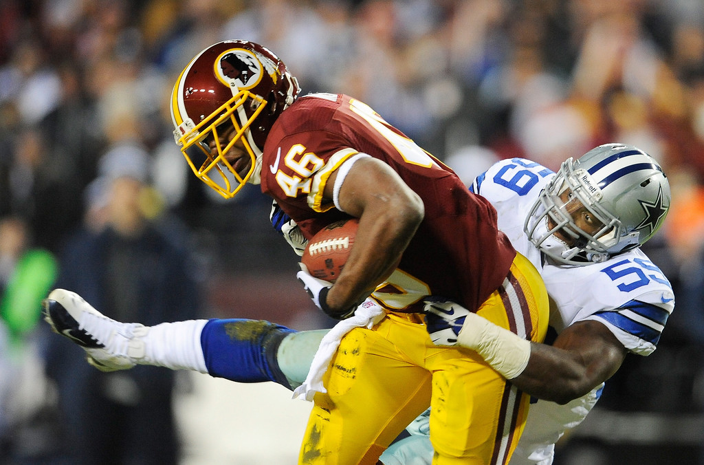 . LANDOVER, MD - DECEMBER 30:   Alfred Morris #46 of the Washington Redskins carries the ball against the defense of  Ernie Sims #59 of the Dallas Cowboys at FedExField on December 30, 2012 in Landover, Maryland.  (Photo by Patrick McDermott/Getty Images)