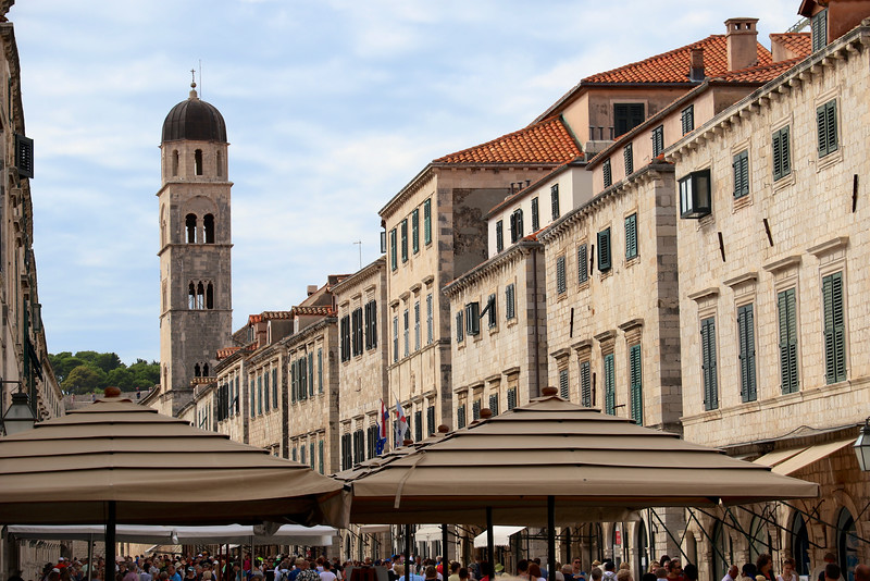 The bell tower of the Franciscan Monastery and Church dominates the western portion of the Stradun (main promenade of the Old City)