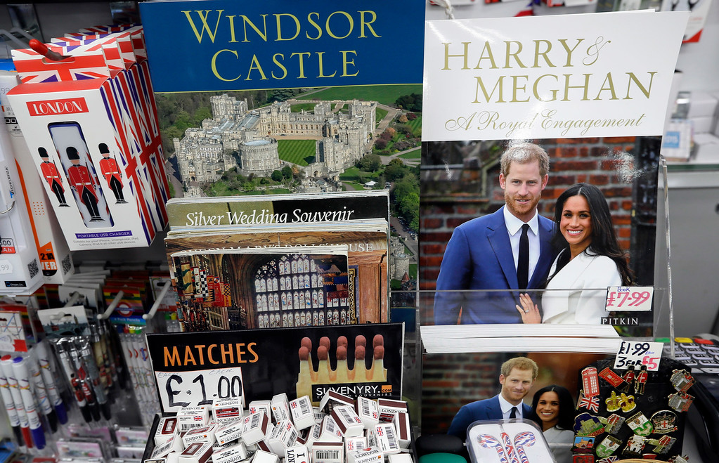 . Memorabilia with a photograph of Britain\'s Prince Harry and Meghan Markle displayed for sale in a shop in Windsor, England, Thursday, March 29, 2018. Britain\'s Prince Harry will marry Meghan Markle in Windsor on May 19. (AP Photo/Kirsty Wigglesworth)