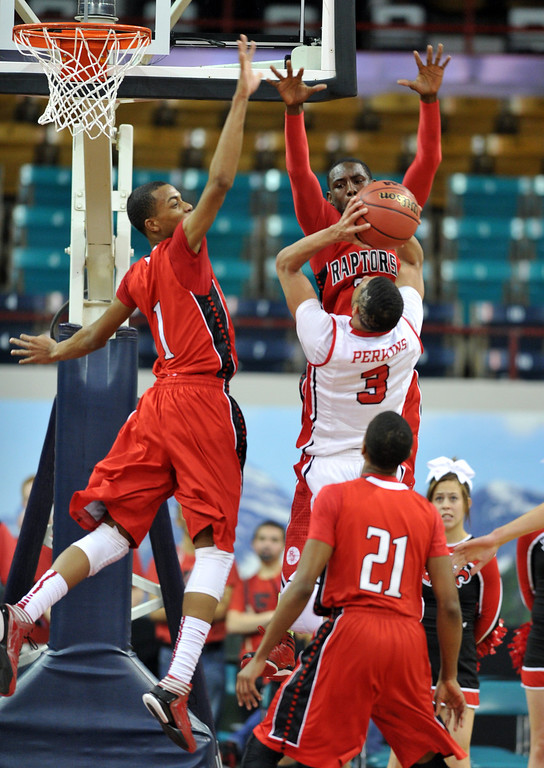 . DENVER, CO. - MARCH 08: Rayjon Craig #1, top left, and TreShawn Wilford #2 of Eaglecrest High School are defending Josh Perkins #3 of Regis High School during 5A State quarter final game at Denver Coliseum. March 8, 2013. Denver, Colorado. Eaglecrest won 64-57. (Photo By Hyoung Chang/The Denver Post)