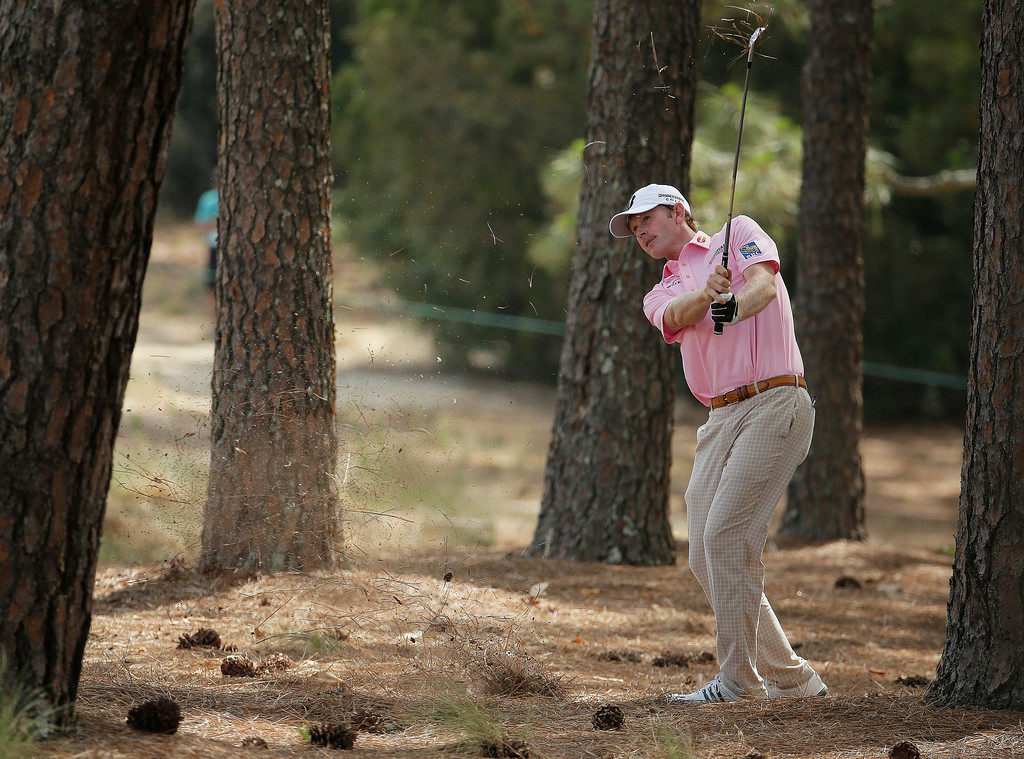 . Brandt Snedeker hits out of the native area on the 11th hole during the first round of the U.S. Open golf tournament in Pinehurst, N.C., Thursday, June 12, 2014. (AP Photo/Charlie Riedel)