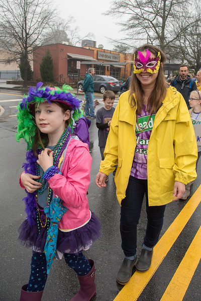 Jessica McLaughlin proudly marches with her daughter in the 2018 Mead Rd. Mardi Gras parade