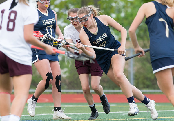 05/10/19 Wesley Bunnell | Staff Newington girls lacrosse defeated Bristol Central in an away game at Bristol Central High School on Friday afternoon. Newington's Maya Gajowiak (19).