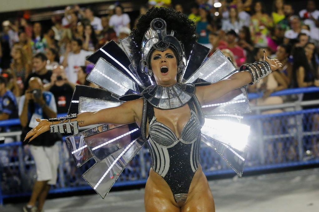 . A performer from the Vila Isabel samba school parades during Carnival celebrations at the Sambadrome in Rio de Janeiro, Brazil, Monday, Feb. 27, 2017. (AP Photo/Leo Correa)