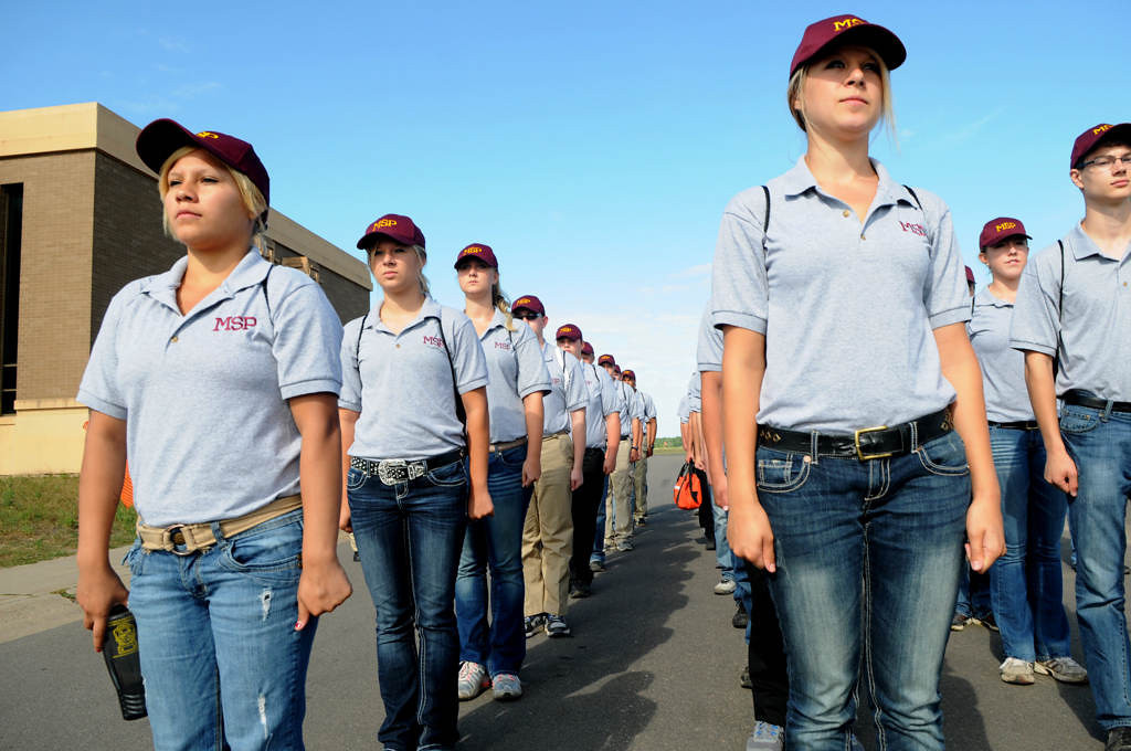 . Cadets line up before marching to vehicles that will transport them to a class on crash reconstruction at a Minnesota State Patrol  High School Summer Camp at Camp Ripley. (Pioneer Press: Jean Pieri)