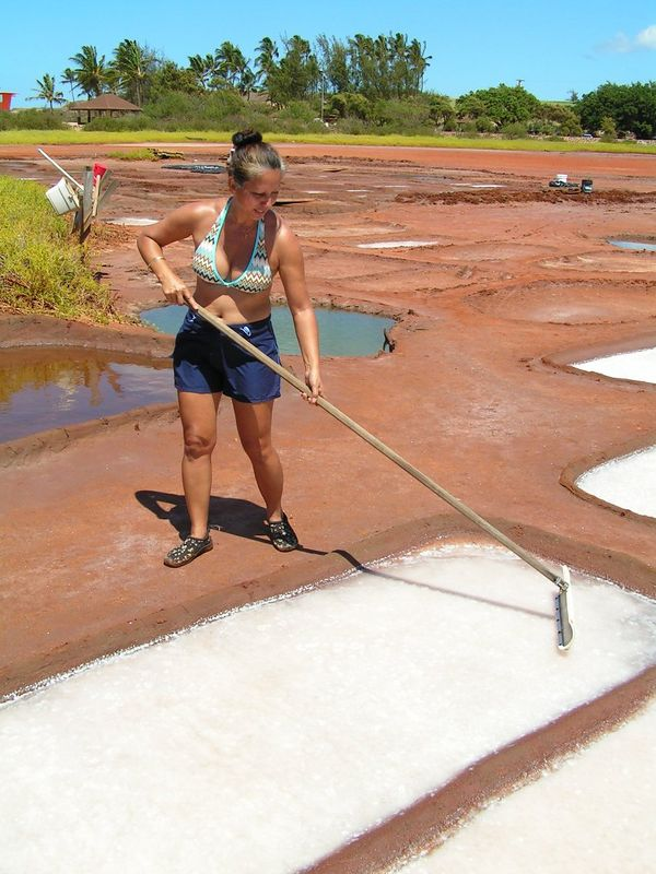 Pict3364sa, cousin Rozalynn, making salt at Salt Ponds , Hanapepe, aug 20, 2005.jpg