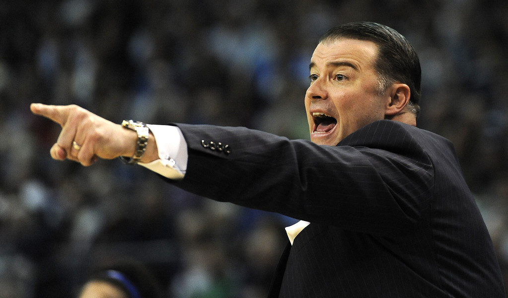. Kentucky head coach Matthew Mitchell calls to his players in the first half of a women\'s NCAA regional final basketball game against Connecticut6 in Bridgeport, Conn., Monday, April 1, 2013. (AP Photo/Jessica Hill)