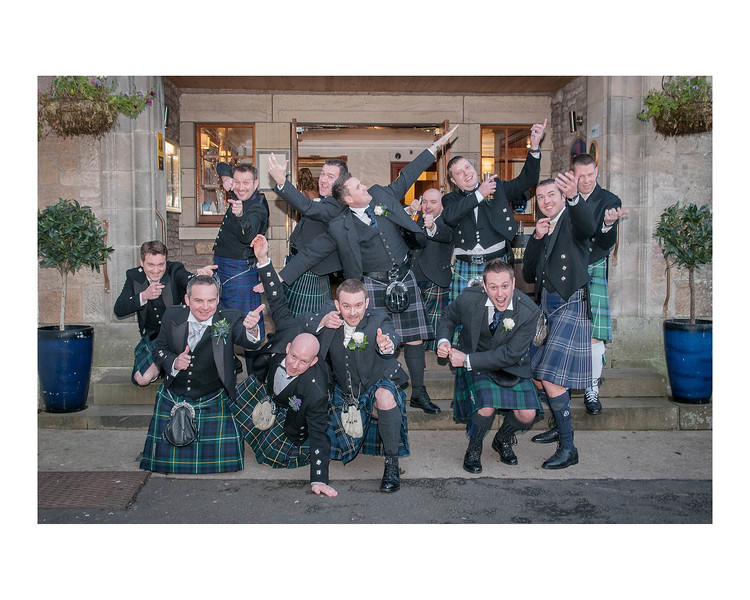 Wedding Photography of Angela & Gordon, Buchannan Arms, Scotland, Photograph is of the groom and groomsmen along with the stag guys recreating there classic pose