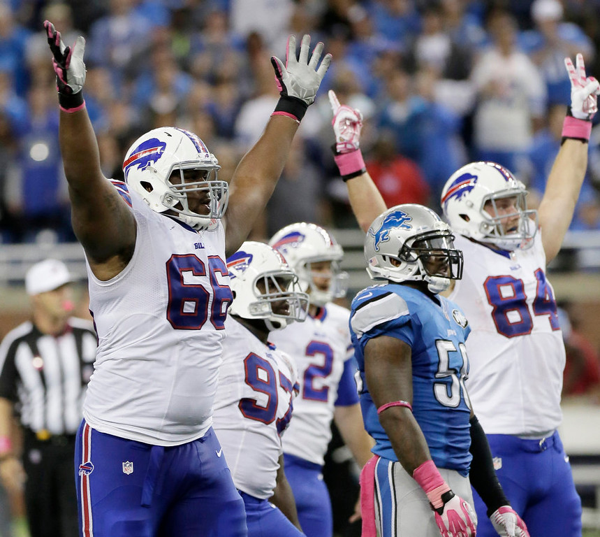. Buffalo Bills tackle Seantrel Henderson (66) celebrates as he watches a 58 -yard game-winning field goal in the fourth quarter of an NFL football game against the Detroit Lions Sunday, Oct. 5, 2014, in Detroit. The Bills defeated the Lions 17-14.(AP Photo/Duane Burleson)