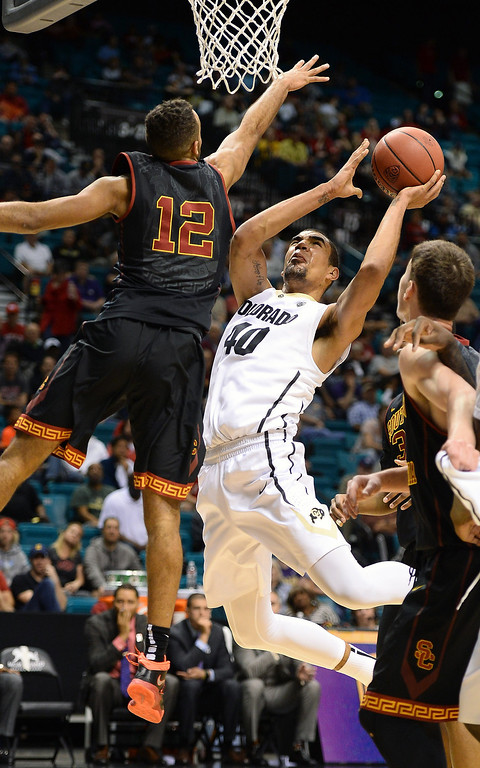 . Josh Scott #40 of the Colorado Buffaloes shoots against Julian Jacobs #12 of the USC Trojans during a first-round game of the Pac-12 Basketball Tournament at the MGM Grand Garden Arena on March 12, 2014 in Las Vegas, Nevada.  (Photo by Ethan Miller/Getty Images)