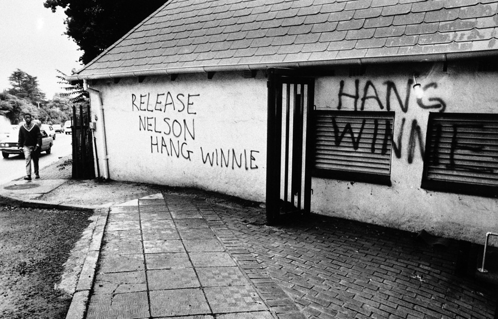 . Graffiti that appeared, Friday, Feb. 17, 1989, Parktown, north of Johannesburg, South Africa. Mrs. Winnie Mandela, wife of jailed African National Congress leader Nelson Mandela, has been in the spotlight recently because of her involvement with a group of bodyguards known as The Mandela United football Club. Members of the club allegedly abducted and killed a youth at Mrs. Mandela\'s home in Soweto. (AP Photo)