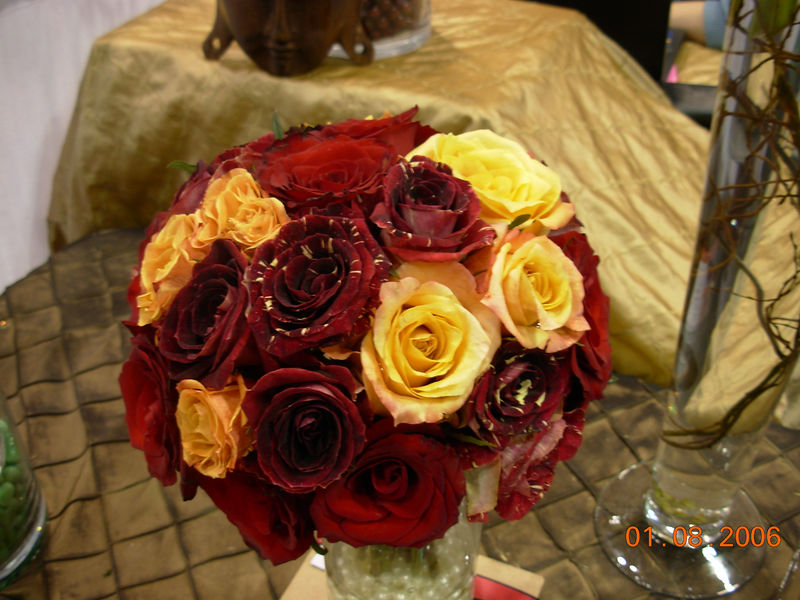 extravaganza jan06 red roses, orange roses & red variegated miniature roses.jpg