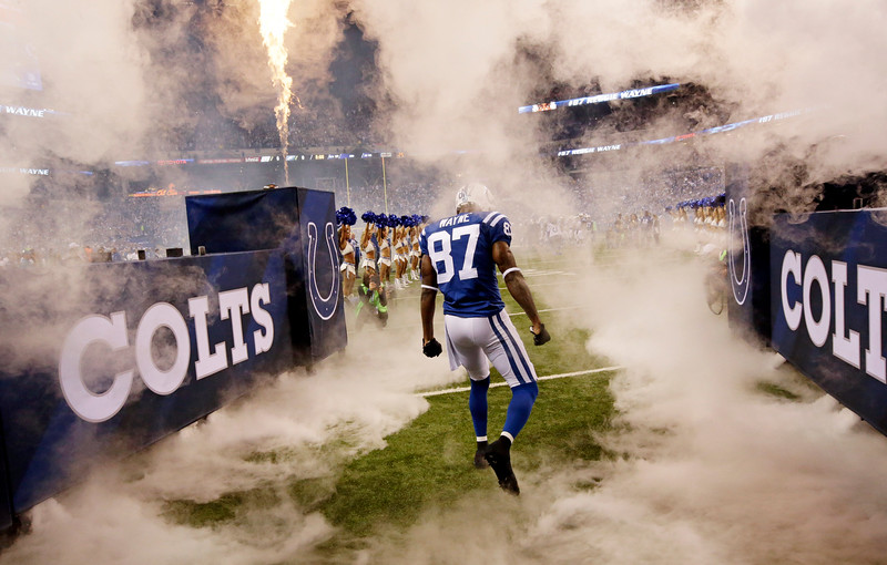 . Indianapolis Colts wide receiver Reggie Wayne (87) runs onto the field during introductions before the start of an NFL football game against the Philadelphia Eagles Monday, Sept. 15, 2014, in Indianapolis. (AP Photo/AJ Mast)