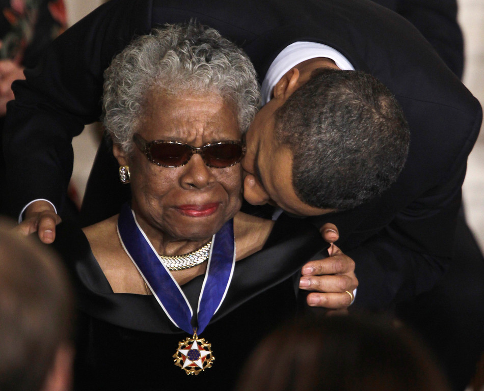 . In this Feb. 15, 2011 file photo, President Barack Obama kisses author and poet Maya Angelou after awarding her the 2010 Medal of Freedom during a ceremony in the East Room of the White House in Washington. (AP Photo/Charles Dharapak, File)