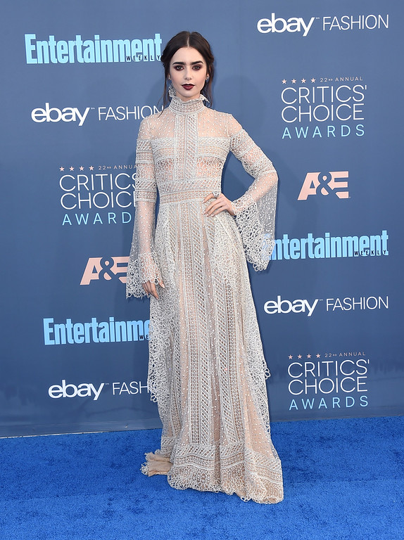 . Lily Collins arrives at the 22nd annual Critics\' Choice Awards at the Barker Hangar on Sunday, Dec. 11, 2016, in Santa Monica, Calif. (Photo by Jordan Strauss/Invision/AP)