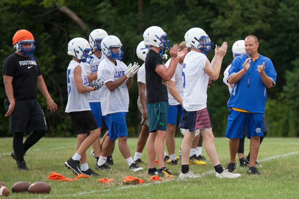 . Jen Forbus - The Morning Journal<br> The Clippers clap during Clearview\'s first football practice on July 30.