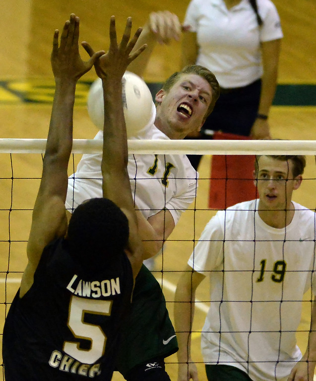 . Damien\'s John Prata (11) scores pass Santa Fe\'s Calvin Lawson (5) scores as Chris Jorritsma (19) looks on in the second game of a prep volleyball match at Damien High School in La Verne, Calif., on Wednesday, May 20, 2015. Damien won 25-17, 25-19, 29-27. (Photo by Keith Birmingham/ Pasadena Star-News)