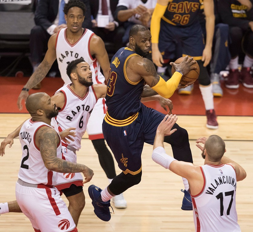 . Cleveland Cavaliers LeBron James, center, drives to the basket against the Toronto Raptors during the first half of Game 3 of an NBA basketball second-round playoff series in Toronto on Friday, May 5, 2017. (Fred Thornhill/The Canadian Press via AP)ia AP)