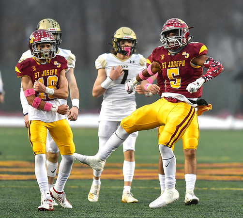 12/14/2019 Mike Orazzi | StaffrSt. Joseph High School's Davee Silas (5) celebrates a sack during 17 win over Daniel Hand at Veteran's Stadium in New Britain on Saturday.