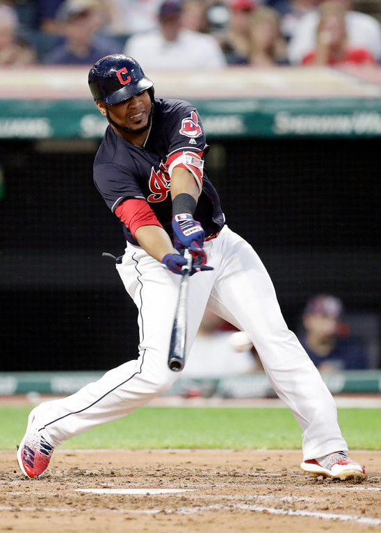 . Cleveland Indians\' Edwin Encarnacion hits an RBI-single off Minnesota Twins starting pitcher Kyle Gibson in the third inning of a baseball game, Tuesday, Aug. 28, 2018, in Cleveland. Michael Brantley scored on the play. (AP Photo/Tony Dejak)
