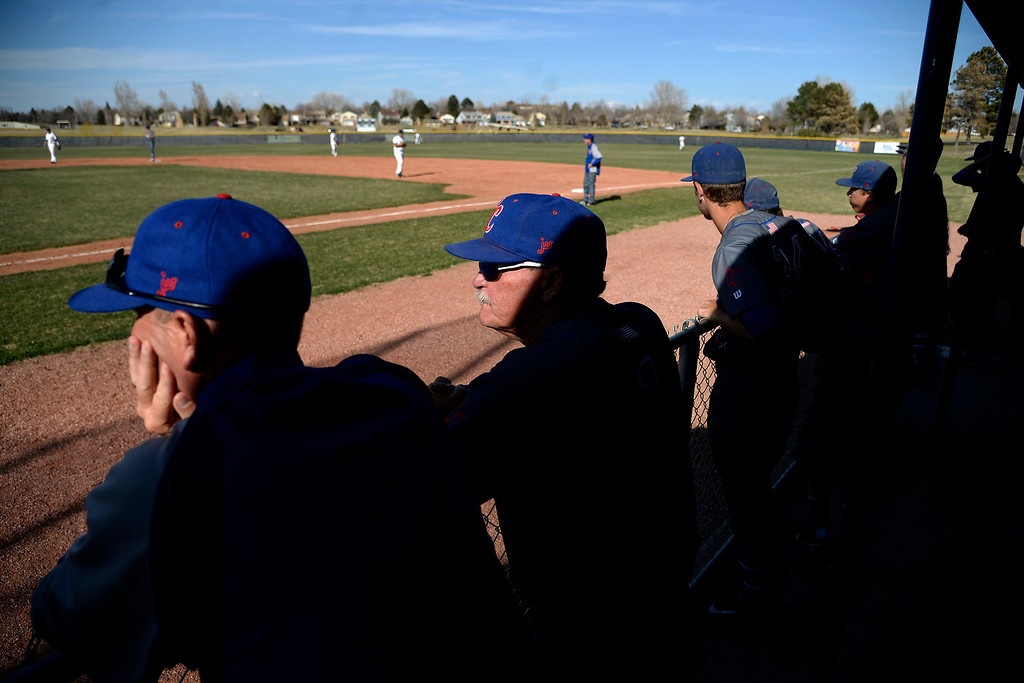 . Aurora, CO - APRIL 08: Head coach Marc Johnson of the Cherry Creek Bruins watches the action against the Overland Trailblazers during the second inning. Overland hosted Cherry Creek on Tuesday, April 8, 2014. (Photo by AAron Ontiveroz/The Denver Post)