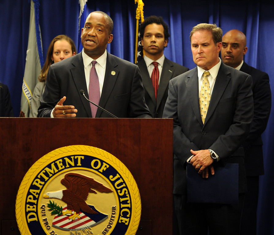 . U.S. Attorney André Birotte Jr., center, and FBI Assistant Director in Charge Bill Lewis stand at the Department of Justice podium in Los Angeles on Friday, Feb. 21, 2014, to announce charges against State Senator Ron Calderon and his brother Tom.that include mail fraud, money laundering, tax evasion, and fraud related to health care. (Photo by John McCoy/Los Angeles Daily News)