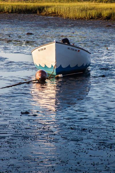 wavy boat reflection wide.jpg