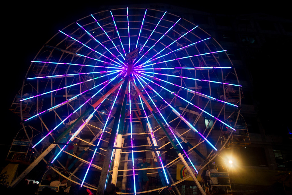 . Festival goers ride a ferris wheel during the annual local night bazaar to mark the Thadingyut festival in downtown Yangon, Myanmar, Wednesday, Oct. 4, 2017. The Thadingyut festival, also known as lighting festival, is held around the country at the end of Buddhist Lent marking Buddha\'s descent from heaven after He sermonized the Abhidamma to His mother who was born in heaven. (AP Photo/Thein Zaw)