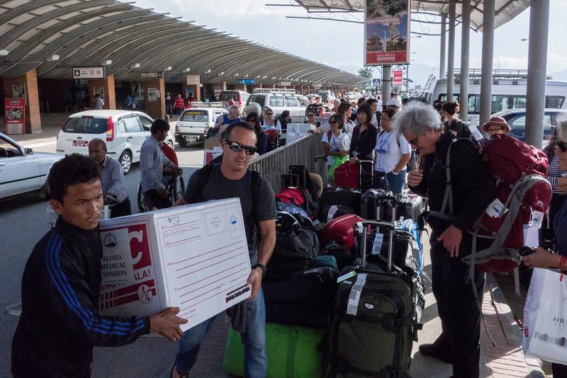 Ron Baker getting into loading boxes at Kathmandu International Airport.
