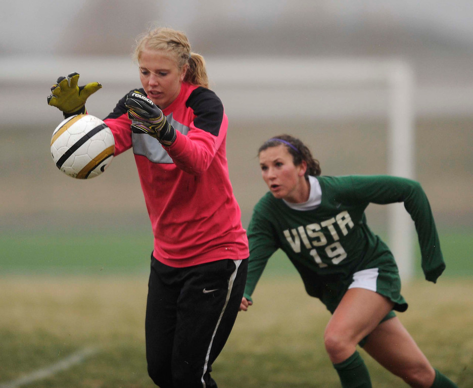. Mustangs\' goalkeeper Abigail Eustace (00) made a save in the second half. The Mountain Vista High School girl\'s soccer team defeated Ponderosa 6-0 Tuesday night, April 2, 2013.  Photo By Karl Gehring/The Denver Post)