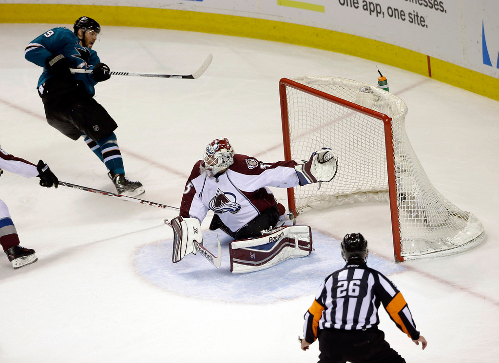 . San Jose Sharks\' Martin Havlat, top left, of the Czech Republic, scores his second goal of the game past Colorado Avalanche goalie Jean-Sebastien Giguere, during the third period of an NHL hockey game Friday, April 11, 2014, in San Jose, Calif. San Jose won 5-1. (AP Photo/Marcio Jose Sanchez)