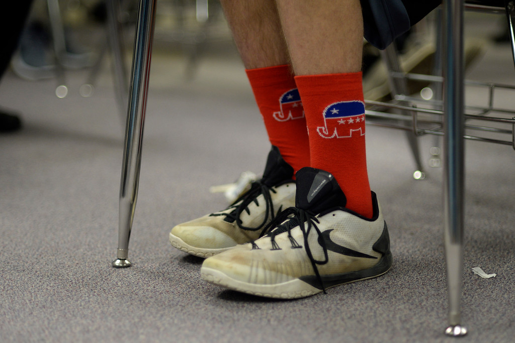 . Teclan Watts rocks GOP socks as republicans caucus at Columbine High School on Tuesday, March 1, 2016. (Photo by AAron Ontiveroz/The Denver Post)