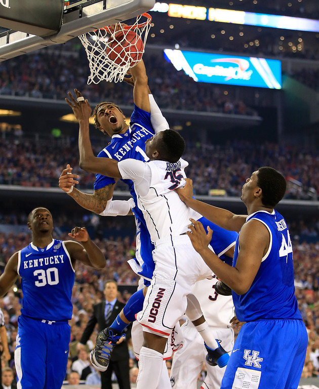 . ARLINGTON, TX - APRIL 07:  James Young #1 of the Kentucky Wildcats dunks over Amida Brimah #35 of the Connecticut Huskies during the NCAA Men\'s Final Four Championship at AT&T Stadium on April 7, 2014 in Arlington, Texas.  (Photo by Jamie Squire/Getty Images)