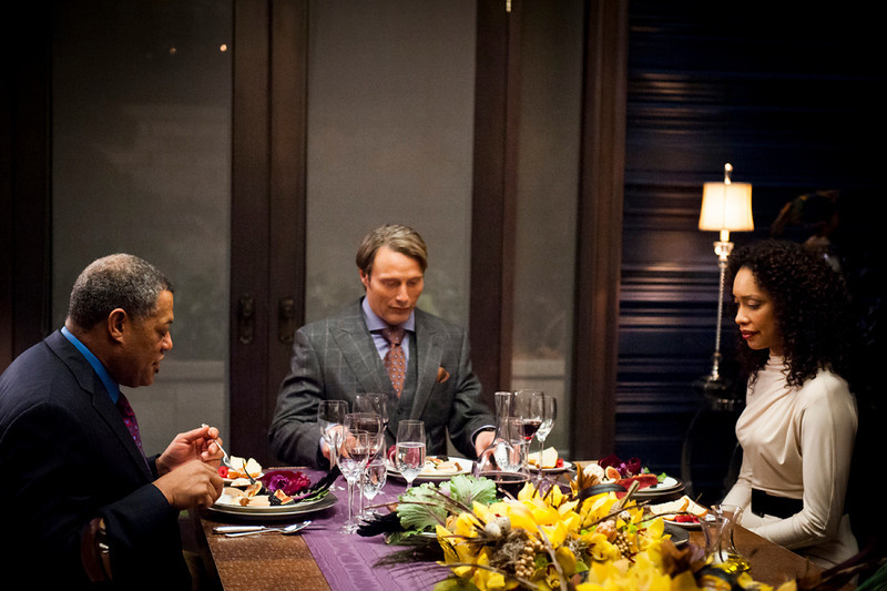 """. Laurence Fishburne (\""""The Matrix\"""") as Jack Crawford, Mads Mikkelsen as Hannibal Lecter and Gina Torres as Bella Crawford in \""""Hannibal,\"""" \""""Coquilles\"""" Episode 106. (Photo by: Brooke Palmer/NBC)"""