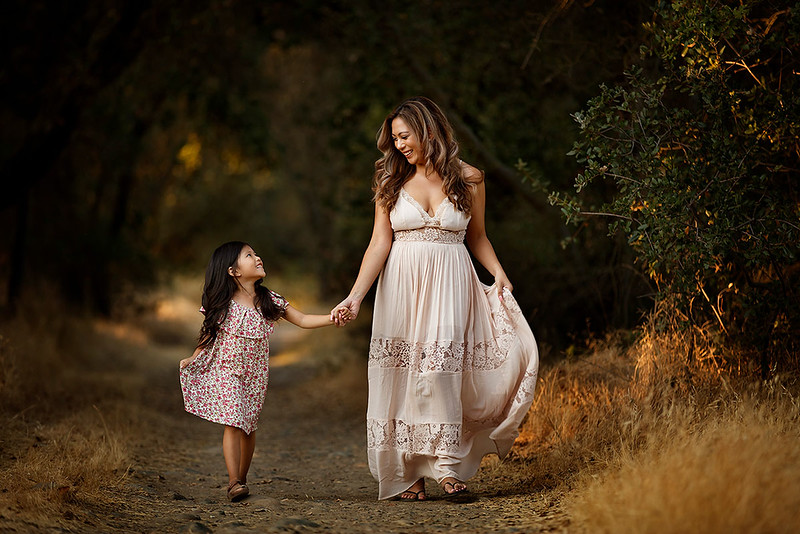 Sacramento family photographer during outdoor portrait session. Mother and daughter portrait at sunset.