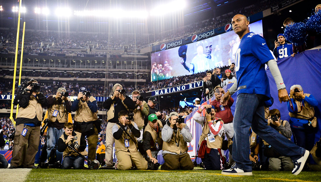 . Retired New York Yankees closer Mariano Rivera takes the field to do the honorary coin flip before the start of the Vikings game against the Giants. (Pioneer Press: Ben Garvin)