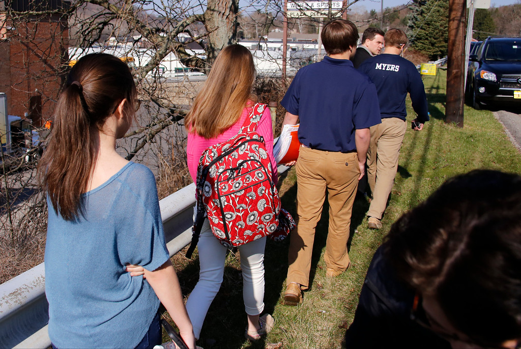 . Students leave the campus of the Franklin Regional School District where several people were stabbed at Franklin Regional High School on Wednesday, April 9, 2014, in Murrysville, Pa., near Pittsburgh. The suspect, a male student, was taken into custody and being questioned. (AP Photo/Gene Puskar)