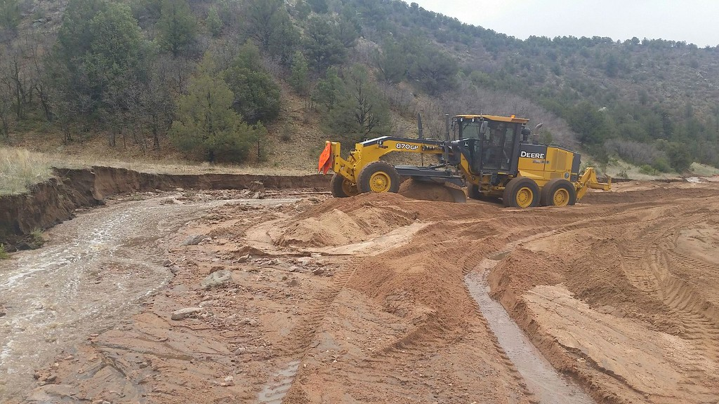 . 22DRFlooding2.jpg Crews work to contain flooding in Fremont County on Thursday. Debbie Bell/Courtesy Photo