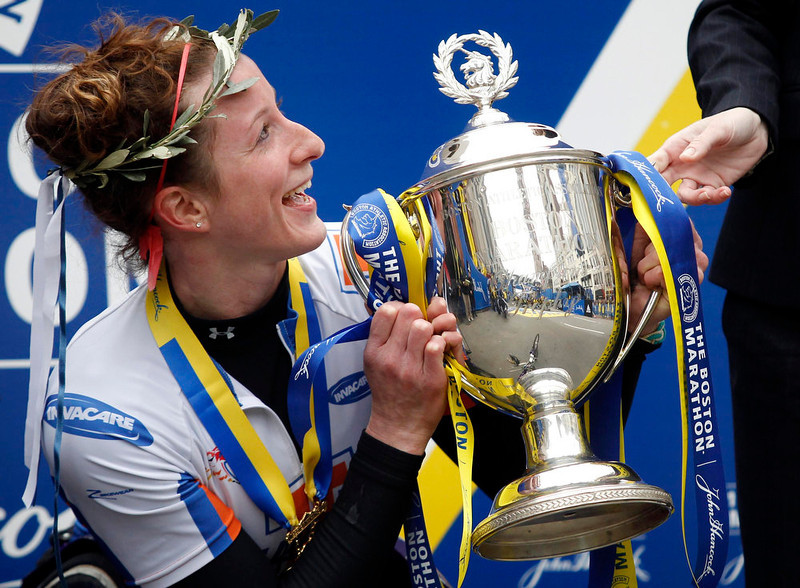 . Tatyana McFadden of the U.S. smiles as she poses for a portrait with the Boston Marathon trophy after winning the women\'s wheelchair division of the 117th Boston Marathon in Boston, Massachusetts April 15, 2013. REUTERS/Jessica Rinaldi