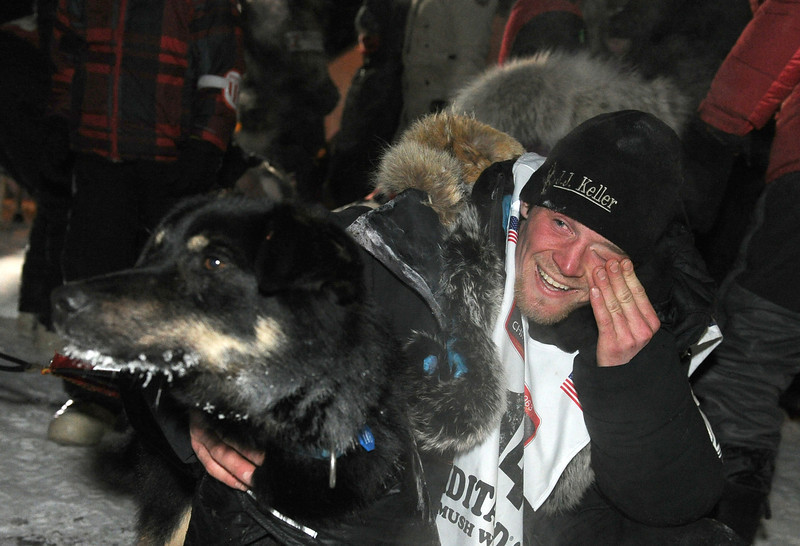 . Dallas Seavey holds one of his dogs after winning the 2014 Iditarod Trail Sled Dog Race in Nome, Alaska, Tuesday, March 11, 2014.  (AP Photo/The Anchorage Daily News, Bob Hallinen)
