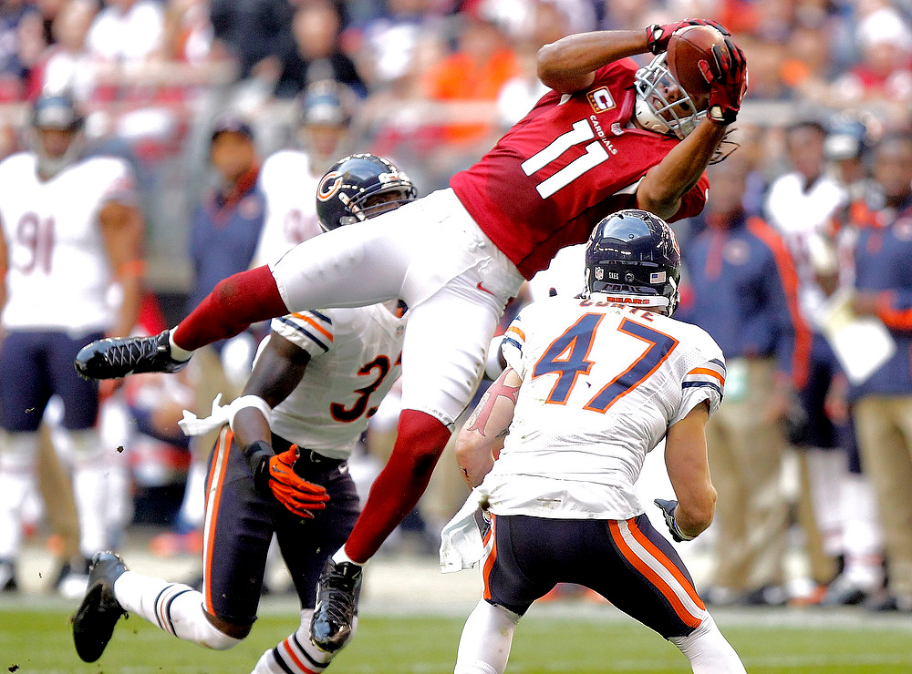 . Arizona Cardinals wide receiver Larry Fitzgerald (11) leaps for a pass as Chicago Bears free safety Chris Conte (47) defends during the first half of an NFL football game, Sunday, Dec. 23, 2012, in Glendale, Ariz. (AP Photo/Paul Connors)