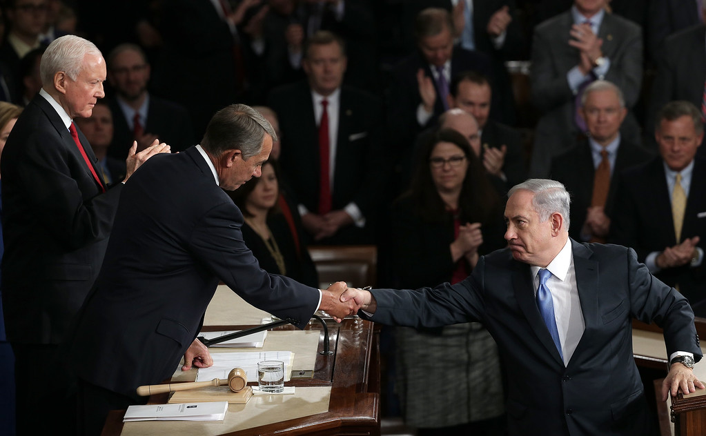""". sraeli Prime Minister Benjamin Netanyahu (R) shakes hands with U.S. Speaker of the House John Boehner (C) (R-OH) after addressing a joint meeting of the United States Congress in the House chamber at the U.S. Capitol March 3, 2015 in Washington, DC. During his speech, Netanyahu said, \""""Today the Jewish people face yet another attempt by another Persian potentate to destroy us.\""""  Also pictured is Sen. Orrin Hatch (R-UT). (Photo by Win McNamee/Getty Images)"""
