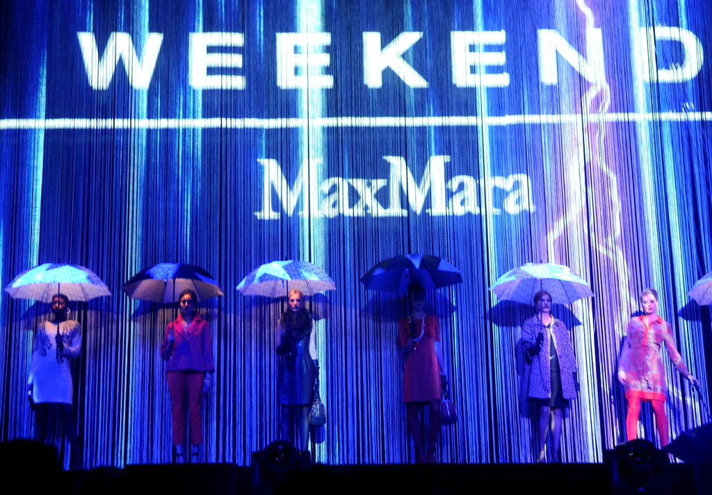 . Models carry umbrellas and wear selections from Weekend Max Mara during the dress rehearsal for the annual Macy\'s Glamorama. (Pioneer Press: Jean Pieri)